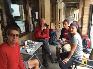 That's cool Phil Wilson (second from left) sipping a warm drink on a cool morning in Los Arcos.